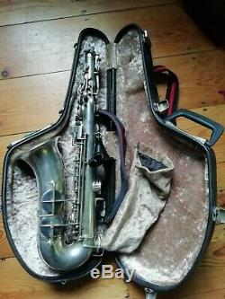 Hawkes and son silver saxophone with mouth piece, neotech strap + hard case